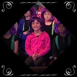 N. singing in Willy Wonka